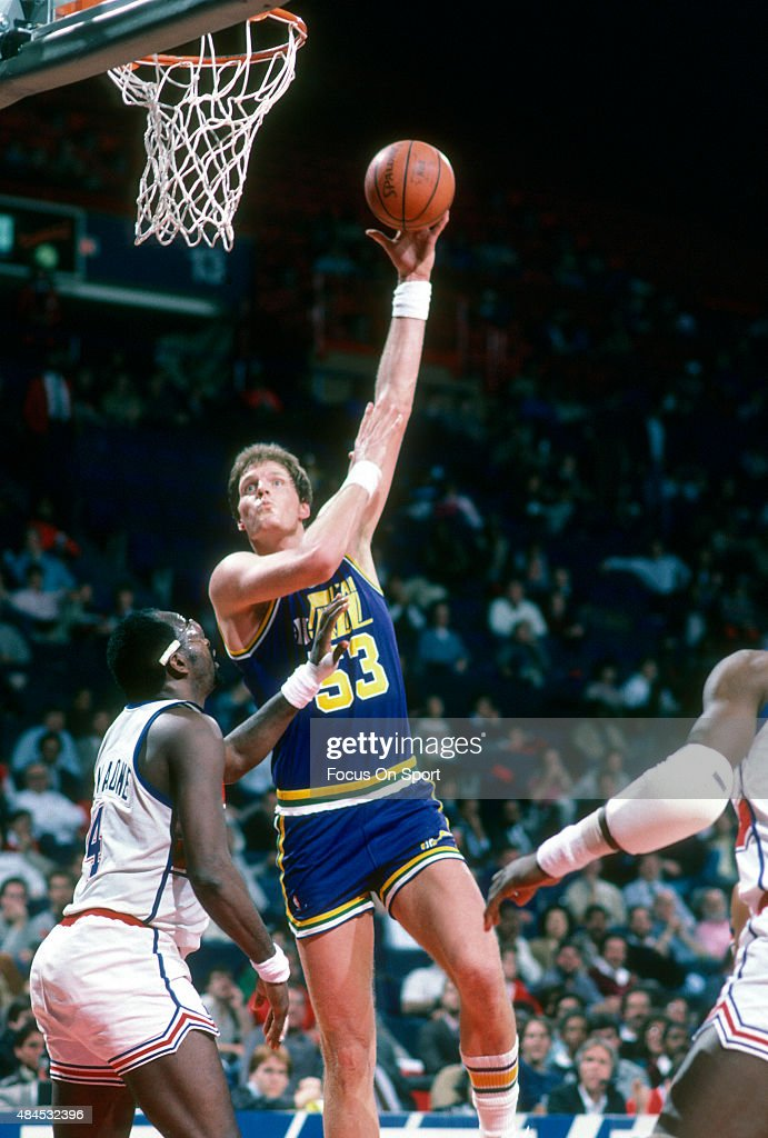 Mark Eaton of the Utah Jazz shoots over Moses Malone of the Washington Bullets during an NBA basketball game circa 1986 at the Capital Centre in...