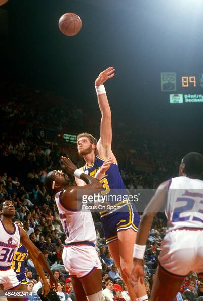 Mark Eaton of the Utah Jazz shoots over Moses Malone of the Washington Bullets during an NBA basketball game circa 1988 at the Capital Centre in...