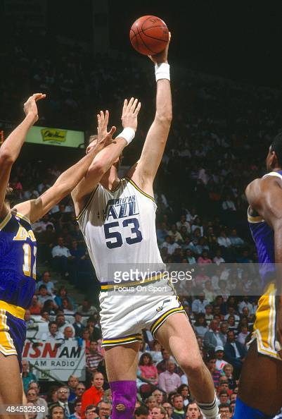 Mark Eaton of the Utah Jazz shoots over Vlade Divac of the Los Angeles Lakers during an NBA basketball game circa 1990 at the Salt Palace in Salt...