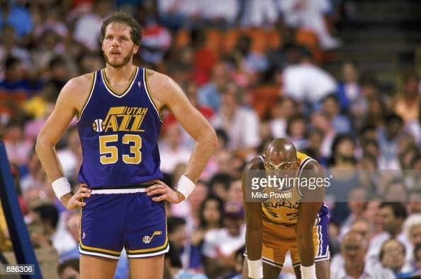 Mark Eaton of the Utah Jazz stands next to Kareem AbdulJabbar of the Los Angeles Lakers during an NBA game at The Salt Palace in Salt Lake City Utah...