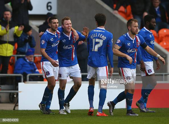 Mark Ellis of Carlisle United celebrates with team mates after scoring their second goal during The Emirates FA Cup Third Round match between...