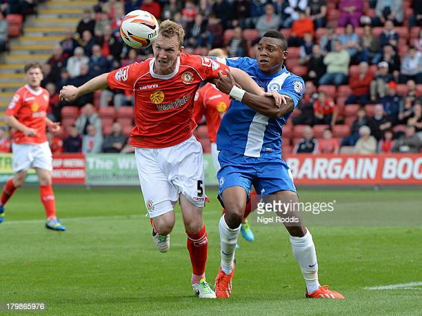 Mark Ellis of Crewe Alexander and Britt Assombalonga of Peterborough United battle for the ball during their Sky Bet League One match at the...