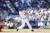 Mark Ellis of the Los Angeles Dodgers bats during Game Five of the National League Championship Series against the St Louis Cardinals on October 16...