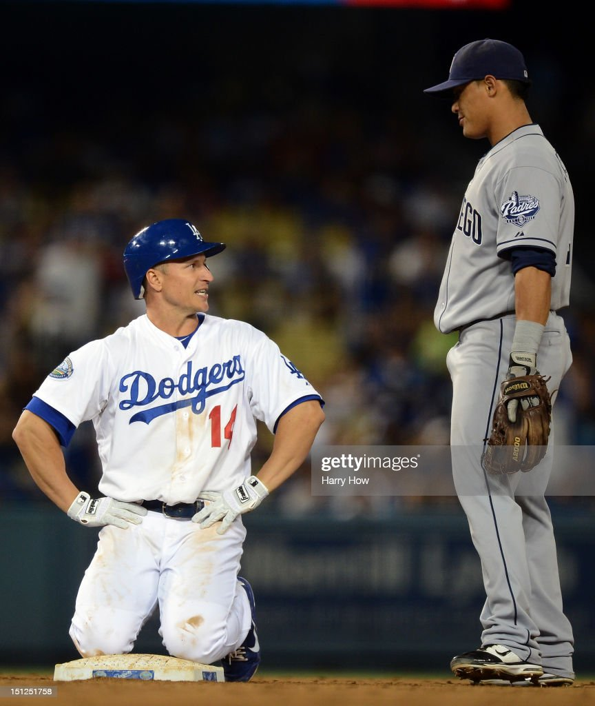 Mark Ellis #14 of the Los Angeles Dodgers reacts to Everth Cabrera #2 of the San Diego Padres after his double during the seventh inning at Dodger Stadium on September 4, 2012 in Los Angeles, California.