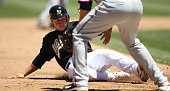 Mark Ellis of the Oakland Athletics slides safely into third base during the game against the Minnesota Twins at the OaklandAlameda County Coliseum...