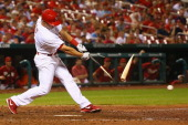 Mark Ellis of the St Louis Cardinals breaks his bat wile batting against the Arizona Diamondbacks in the ninth inning at Busch Stadium on May 21 2014...