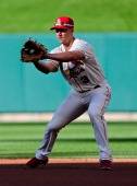 Mark Ellis of the St Louis Cardinals fields a ground ball during the first inning against the Washington Nationals at Busch Stadium on June 14 2014...