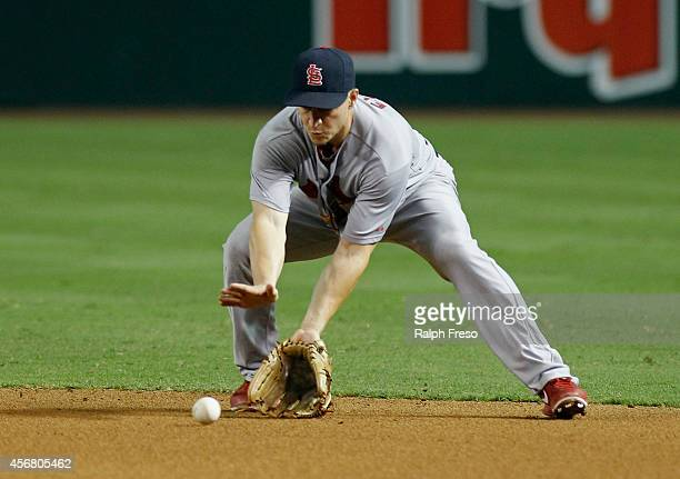 Mark Ellis of the St Louis Cardinals fields a ground ball during the fourth inning of a MLB game against the Arizona Diamondbacks at Chase Field on...