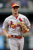 Mark Ellis of the St Louis Cardinals runs off the field during the game against the Colorado Rockies at Coors Field on June 25 2014 in Denver...