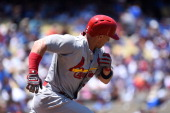 Mark Ellis of the St Louis Cardinals runs to first base against the Los Angeles Dodgers at Dodger Stadium on June 29 2014 in Los Angeles California