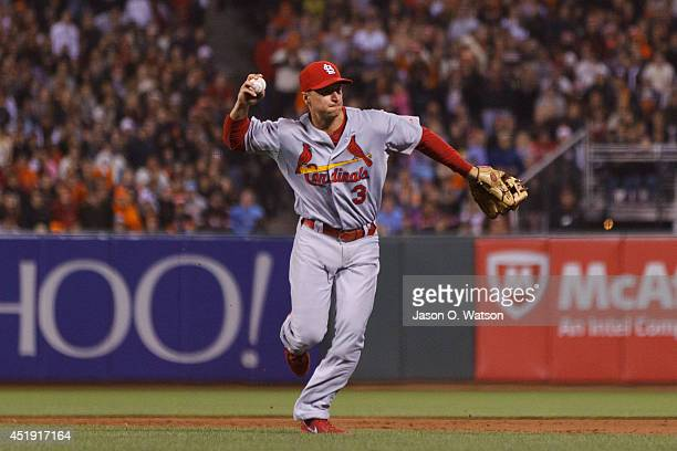 Mark Ellis of the St Louis Cardinals throws to first base against the San Francisco Giants during the ninth inning at ATT Park on July 2 2014 in San...