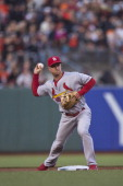 Mark Ellis of the St Louis Cardinals throws to first base to complete a double play against the San Francisco Giants during the second inning at ATT...