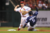 Mark Ellis of the St Louis Cardinals turns a double play in the fifth inning against the San Diego Padres at Busch Stadium on August 14 2014 in St...