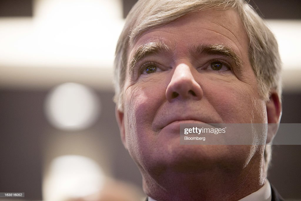 Mark Emmert, president of the National Collegiate Athletic Association (NCAA), watches a news conference in New York, U.S., on Monday, March 3, 2013. The National Football League, General Electric Co. and Under Armour Inc. will join in a four-year, $60 million effort to develop imaging technology for detecting, treating and preventing brain injuries. Photographer: Scott Eells/Bloomberg via Getty Images