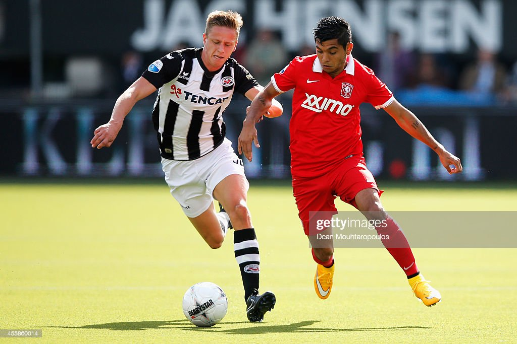 Mark Engberink of Heracles tackles Jesus Corona of Twente during the Dutch Eredivisie match between Heracles Almelo and FC Twente at Polman Stadion...