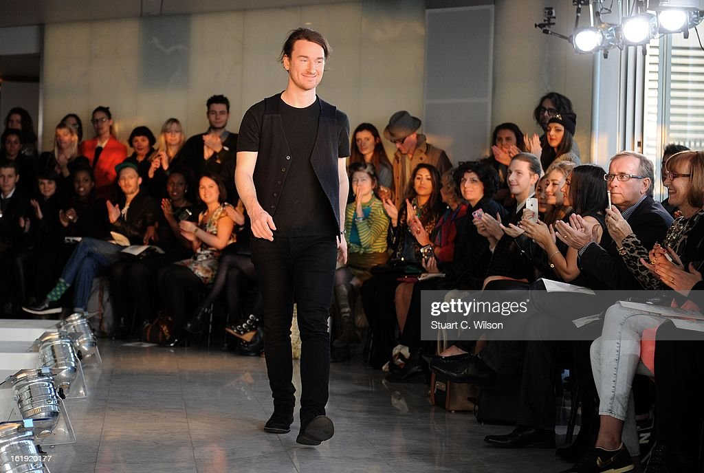 Mark Fast appears after his salon show during London Fashion Week Fall/Winter 2013/14 at ME Hotel on February 17, 2013 in London, England.