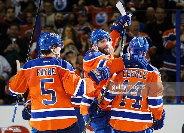 Mark Fayne Patrick Maroon and Jordan Eberle of the Edmonton Oilers celebrate a goal against the Vancouver Canucks on April 6 2016 at Rexall Place in...