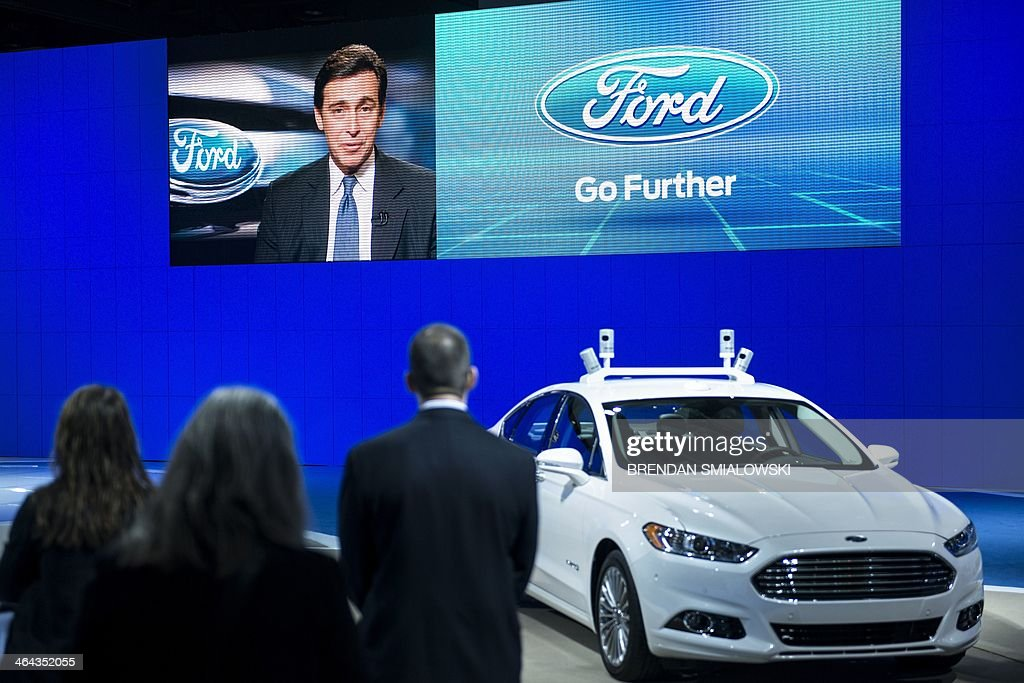 Mark Fields, Chief Operating Officer of Ford, is seen speaking via satellite during the Washington Auto Show at the Washington Convention Center January 22, 2014 in Washington, DC. AFP PHOTO/Brendan SMIALOWSKI