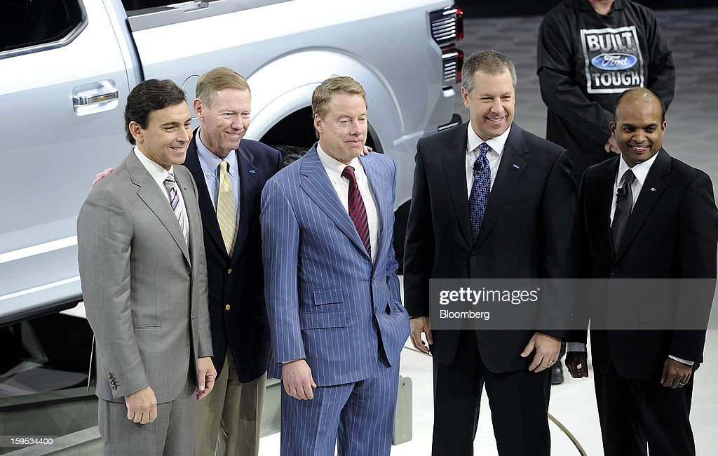 Mark Fields, chief operating officer of Ford Motor Co., from left, Alan Mulally, president and chief executive officer, and Bill Ford, executive chairman of Ford Motor Co., stand for a photograph with other executives in front of the F-150 Atlas concept truck during the 2013 North American International Auto Show (NAIAS) in Detroit, Michigan, U.S., on Tuesday, Jan. 15, 2013. Ford Motor Co., trying to fend off new pickups from competitors targeting its top-selling F-Series, showed an F-150 prototype with features that boost fuel economy and foreshadow its future for the segment. Photographer: David Paul Morris/Bloomberg via Getty Images