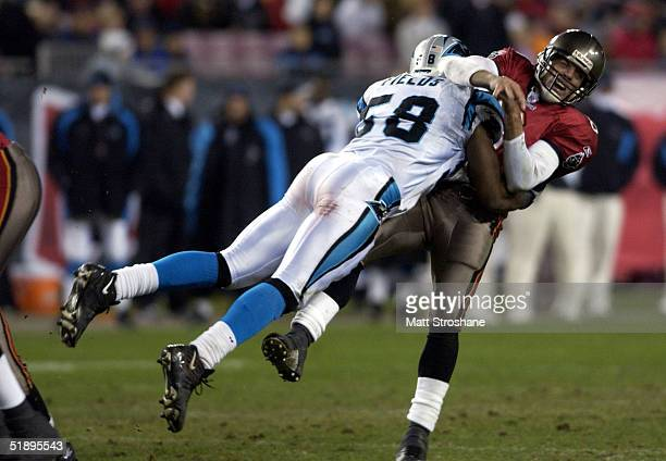 Mark Fields of the Carolina Panthers hits Brian Griese of the Tampa Bay Buccaneers during the second half at Raymond James Stadium on December 26...
