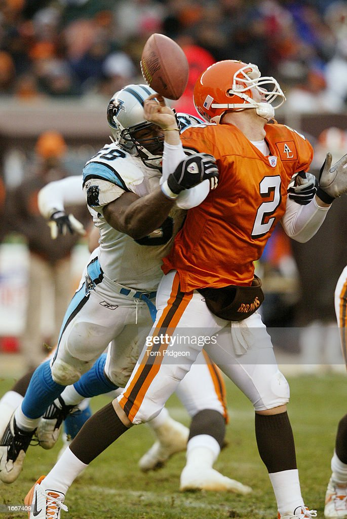 Mark Fields #58 of the Carolina Panthers sacks quarterback Tim Couch #2 of the Cleveland Browns causing a fumble on December 1, 2002 at Browns Stadium in Cleveland, Ohio. Carolina won the game 13-6.