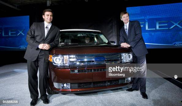Mark Fields president of the Americas for Ford Motor Co left poses with former hockey player Wayne Gretzky with a new Ford Flex at the Ford Motor Co...