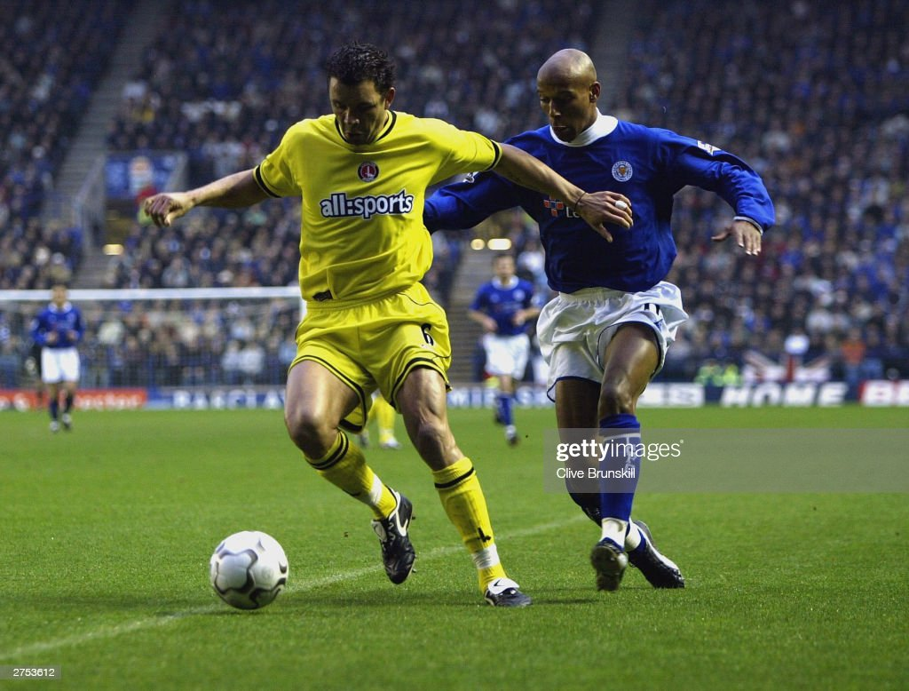 Mark Fish of Charlton holds off Jordan Stuart of Leicester during the FA Barclaycard Premiership match between Leicester City and Charlton Athletic at Walkers Stadium on Novermber 22, 2003 in Leicester, England.