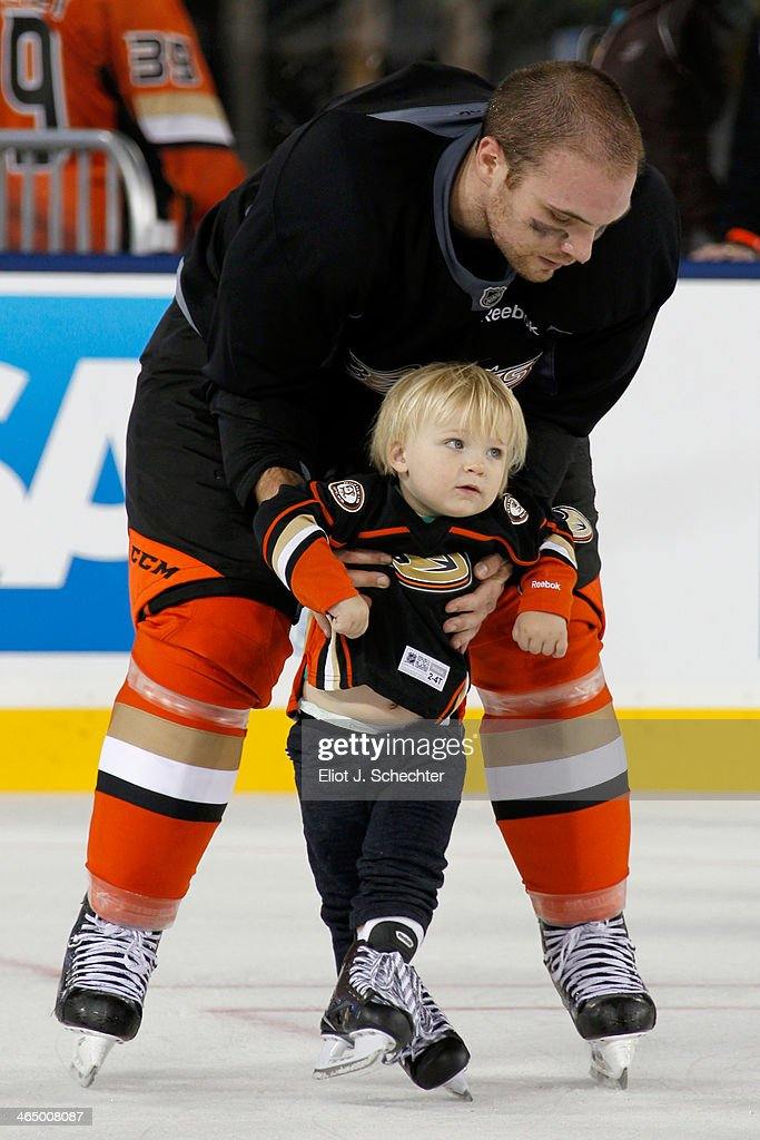 <a gi-track='captionPersonalityLinkClicked' href=/galleries/search?phrase=Mark+Fistric&family=editorial&specificpeople=2129692 ng-click='$event.stopPropagation()'>Mark Fistric</a> #28 of the Anaheim Ducks skates with his son during the family skate following team practice for the 2014 Coors Light NHL Stadium Series against Los Angeles Kings at Dodger Stadium on January 24, 2014 in Los Angeles, California.