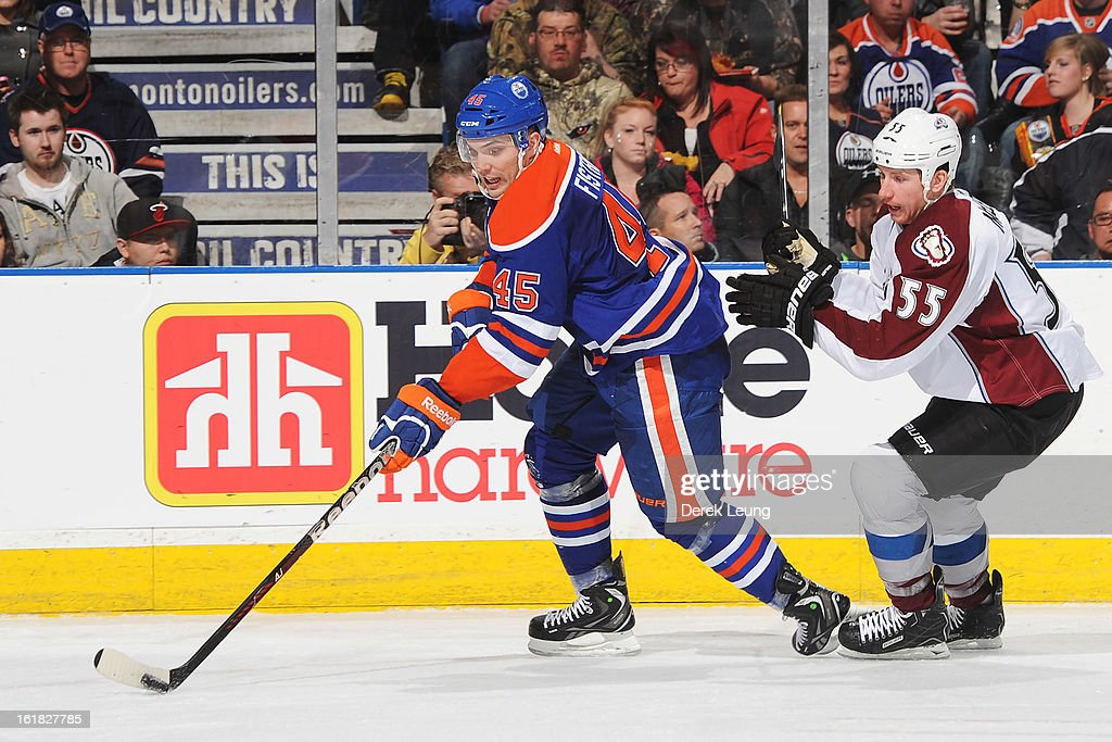 <a gi-track='captionPersonalityLinkClicked' href=/galleries/search?phrase=Mark+Fistric&family=editorial&specificpeople=2129692 ng-click='$event.stopPropagation()'>Mark Fistric</a> #45 of the Edmonton Oilers skates past the defense of <a gi-track='captionPersonalityLinkClicked' href=/galleries/search?phrase=Cody+McLeod&family=editorial&specificpeople=2242985 ng-click='$event.stopPropagation()'>Cody McLeod</a> #55 of the Colorado Avalanche during the NHL game at Rexall Place on February 16, 2013 in Edmonton, Alberta, Canada.