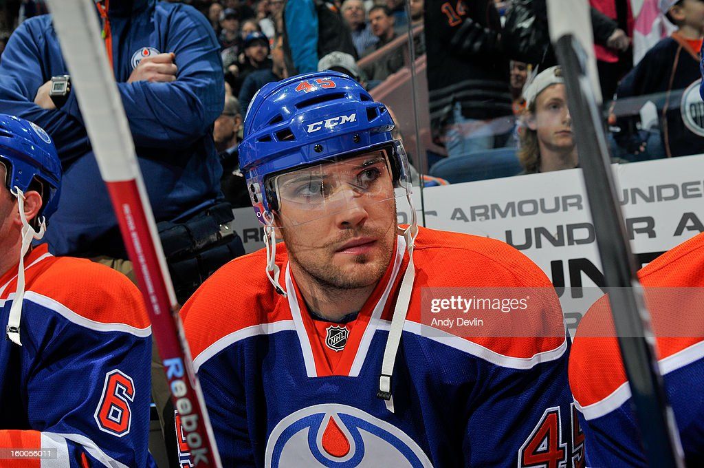 Mark Fistric #45 of the Edmonton Oilers watches from the bench in a game against the Los Angeles Kings at Rexall Place on January 24, 2013 in Edmonton, Alberta, Canada.