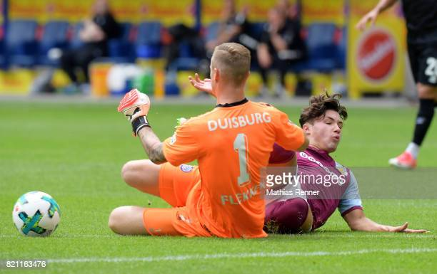 Mark Flekken of MSV Duisburg and Jack Grealish of Aston Villa during the game between Aston Villa and the MSV Duisburg on July 23 2017 in Duisburg...