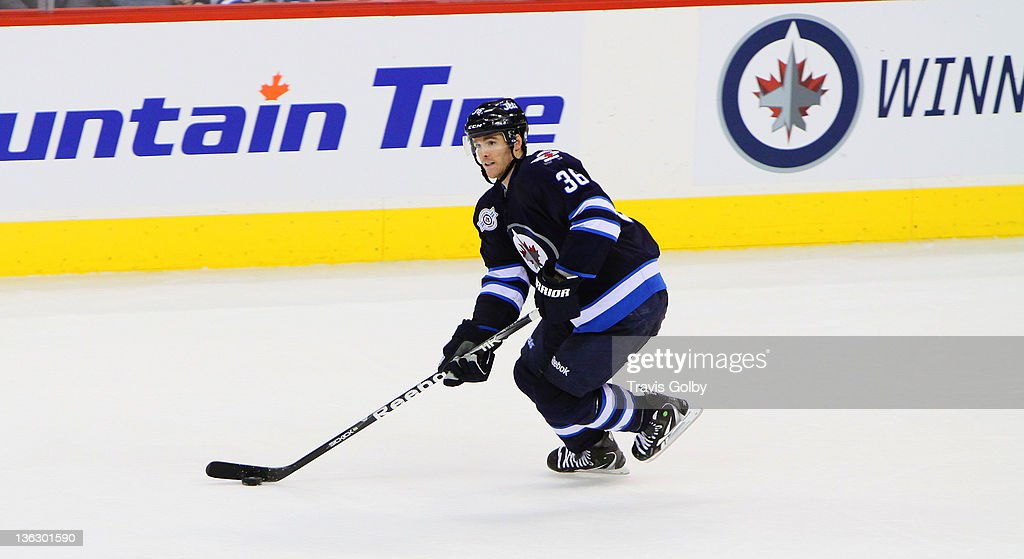 Mark Flood #36 of the Winnipeg Jets carries the puck up the ice during third period action against the Toronto Maple Leafs at the MTS Centre on December 31, 2011 in Winnipeg, Manitoba, Canada.