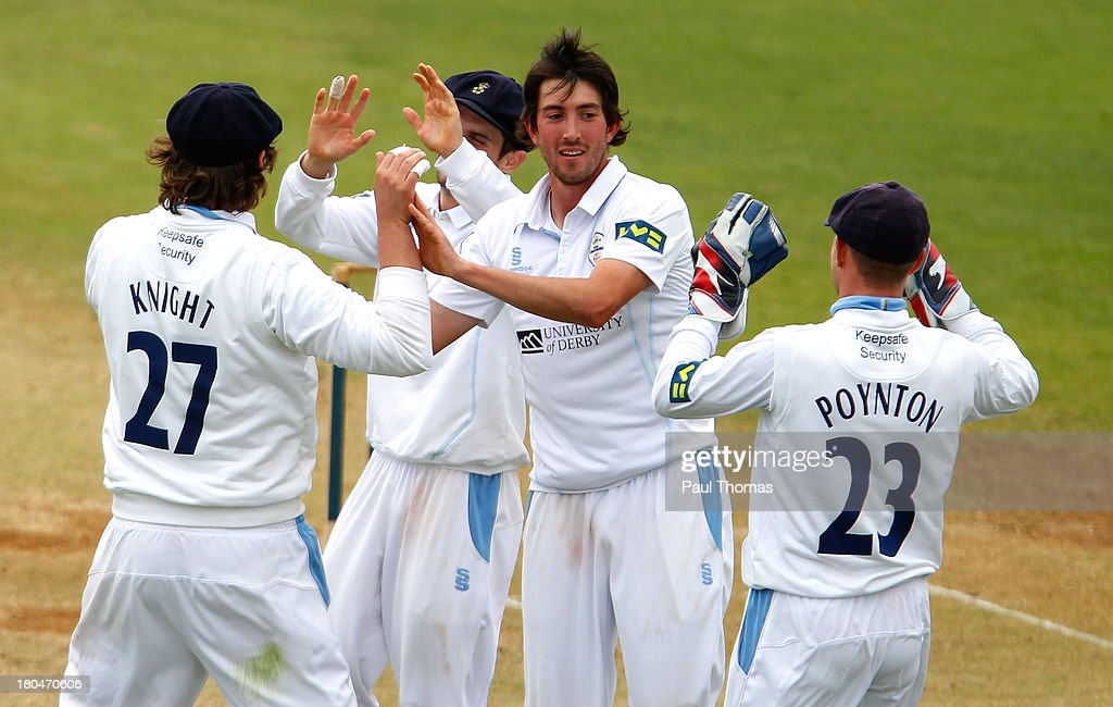 Mark Footitt (C) of Derbyshire celebrates with team mates after taking the wicket of Durham's Will Smith (not pictured) during the LV County Championship match between Derbyshire and Durham at The County Ground on September 13, 2013 in Derby, England.