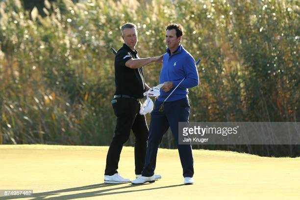Mark Foster of England and Gonzalo FernandezCastano of Spain celebrate earning their tour cards during the final round of the European Tour...