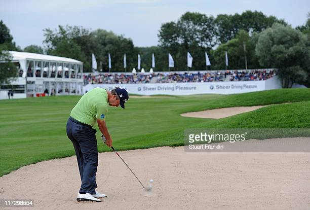 Mark Foster of England plays his bunker shot on the 18th hole during the third round of the BMW International Open at the Munich North Eichenried...