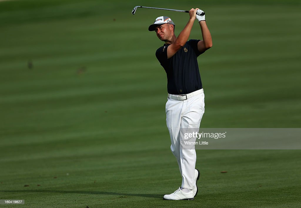 Mark Foster of England plays his second shot on the eighth hole during the first round of the Omega Dubai Desert Classic at Emirates Golf Club on January 31, 2013 in Dubai, United Arab Emirates.