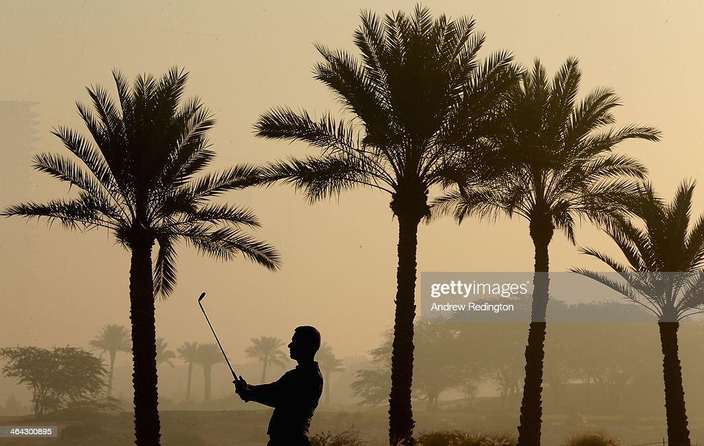 Mark Foster of England plays his third shot on the tenth hole during the first round of the Commercial Bank Qatar Masters at Doha Golf Club on January 22, 2014 in Doha, Qatar.