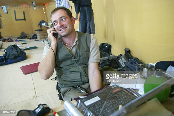 Mark Franchetti from the 'London Sunday Times' receives a congratulatory phone call after winning the United Kingdom Foreign Reporter of the Year...