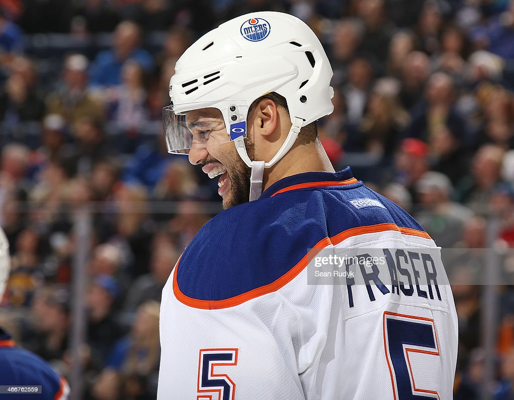 <a gi-track='captionPersonalityLinkClicked' href=/galleries/search?phrase=Mark+Fraser+-+Ice+Hockey+Player&family=editorial&specificpeople=5513661 ng-click='$event.stopPropagation()'>Mark Fraser</a> #5 of the Edmonton Oilers shares a laugh with officials during a break in the game against the Buffalo Sabres at First Niagara Center on February 3, 2014 in Buffalo, New York.