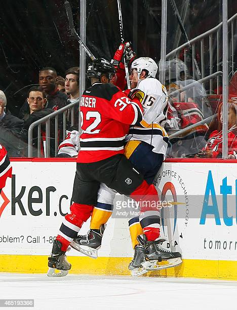 Mark Fraser of the New Jersey Devils checks Craig Smith of the Nashville Predators at the Prudential Center on March 3 2015 in Newark New Jersey