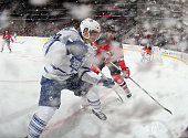 Mark Fraser of the New Jersey Devils moves in to check David Booth of the Toronto Maple Leafs during the first period at the Prudential Center on...