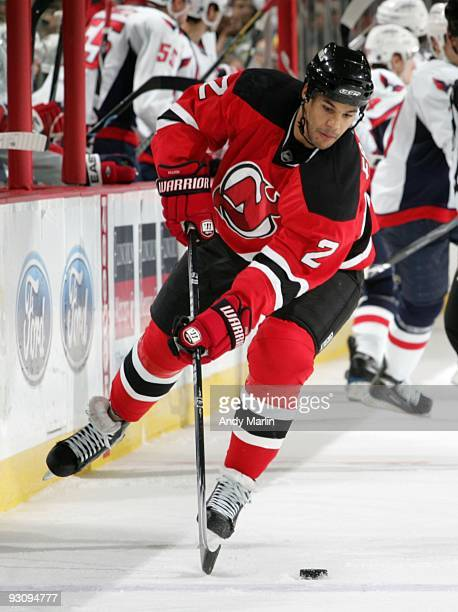 Mark Fraser of the New Jersey Devils plays the puck against the Washington Capitals during the game at the Prudential Center on November 14 2009 in...