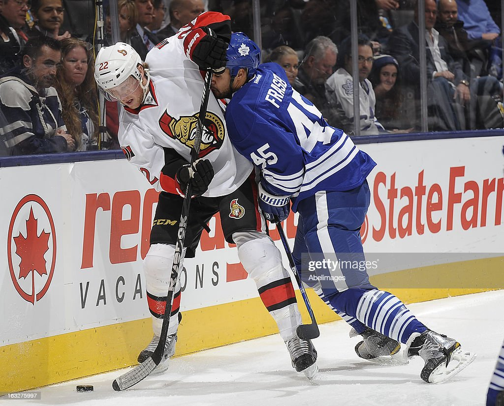 Mark Fraser #45 of the Toronto Maple Leafs battles for the puck with Erik Condra #22 of the Ottawa Senators during NHL game action March 6, 2013 at the Air Canada Centre in Toronto, Ontario, Canada.