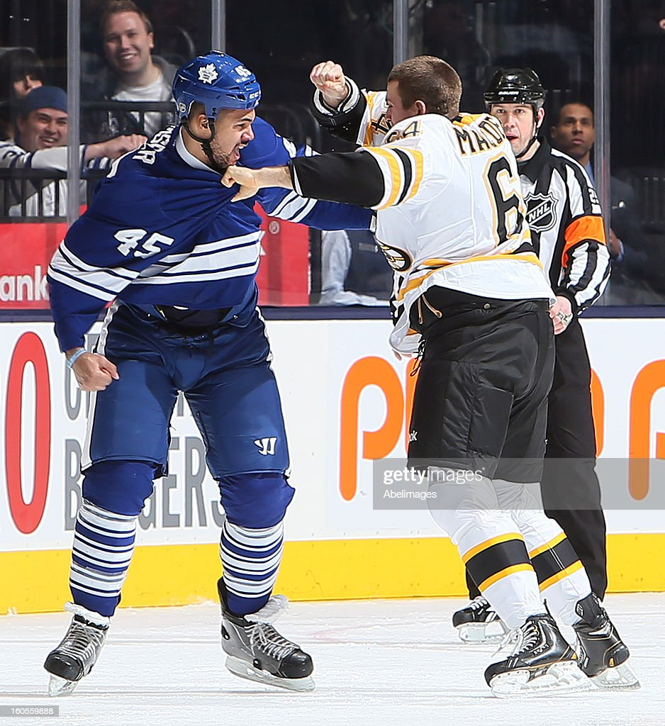 Mark Fraser #45 of the Toronto Maple Leafs fights Lane MacDermid #64 of the Boston Bruins during NHL action at the Air Canada Centre February 2, 2013 in Toronto, Ontario, Canada.