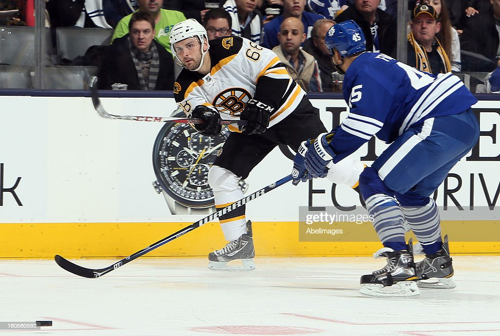 Mark Fraser #45 of the Toronto Maple Leafs tries to block the shot of Jamie Tardif #68 of the Boston Bruins during NHL action at the Air Canada Centre February 2, 2013 in Toronto, Ontario, Canada.