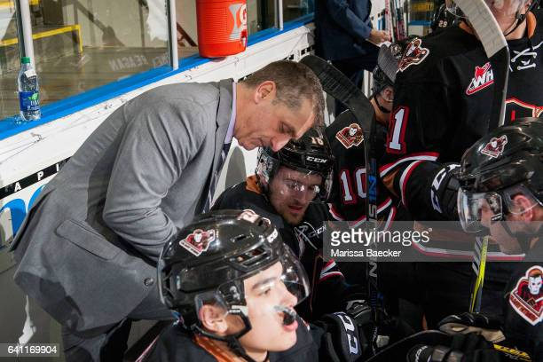 Mark French head coach goes over a play on the bench with Jake Kryski of the Calgary Hitmen against the Kelowna Rockets on February 1 2017 at...