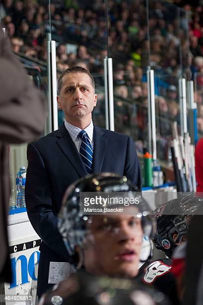Mark French head coach of the Calgary Hitmen stands on the bench against the Kelowna Rockets on February 28 2015 at Prospera Place in Kelowna British...