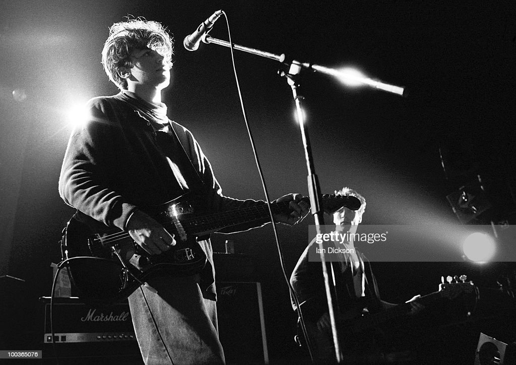 Mark Gardener and Andy Bell (right) from Ride perform live on stage at The Astoria in London on January 14 1990