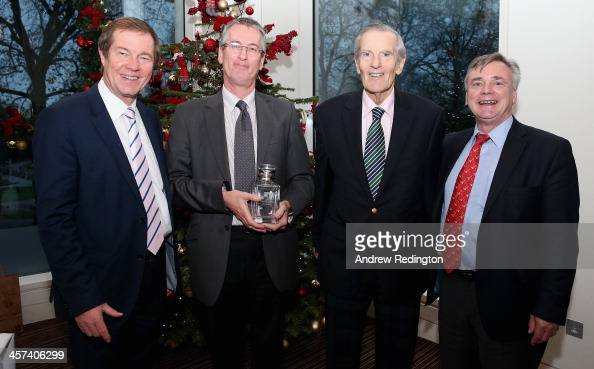 Mark Garrod is presented with a special award by George O'Grady Chief Executive of The European Tour along with Mark Wilson and Ken Schofield during...
