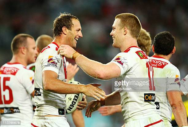 Mark Gasnier and Ben Creagh of the Dragons celebrate a try by Gasnier during the round six NRL match between the South Sydney Rabbitohs and the St...